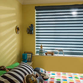 Blue modern window blinds on a yellow wall