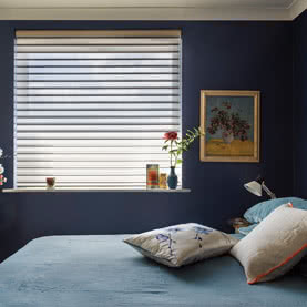 Silhouette blinds in modern bedroom