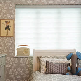 White sheer Duette blinds in children's bedroom