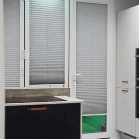 Grey blinds on French doors