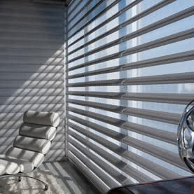 Side view of electric office blinds on large window