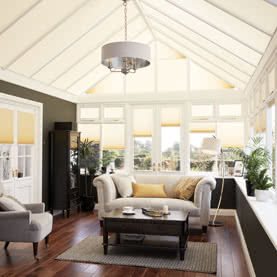 Cream Duette thermal blinds in a conservatory