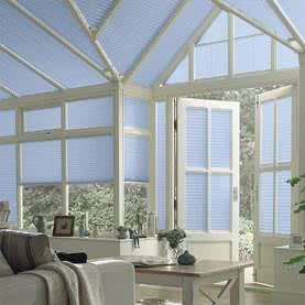Purple Pleated blinds on conservatory windows and roof
