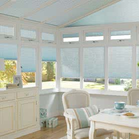 Blue Pleated blinds in conservatory
