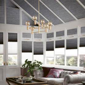 Grey Twin Shade blinds on conservatory windows and roof