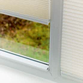 Duette blinds fit between the frame and glass of windows