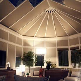 Night shot of conservatory roof with electric Pleated blinds