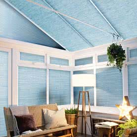 Blue Pleated blinds on slanted conservatory roof