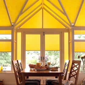 Yellow conservatory roof blinds in specialist design