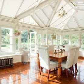 White roof blinds in large conservatory