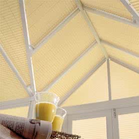 Close up of cream Duette conservatory roof blinds
