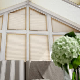 Gable wall with cream Laura Ashley blinds