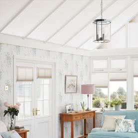 Made to measure white conservatory roof blinds