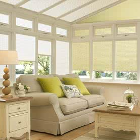 Electric cream Laura Ashley blinds in conservatory