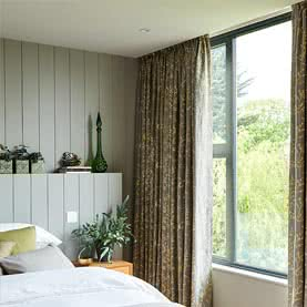 Grey and yellow curtains in bedroom