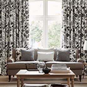 Monochrome curtains with matching cushions in living room