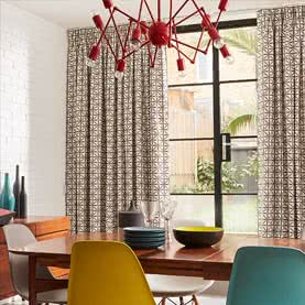 Patterned Pencil Pleat curtains in a dining room