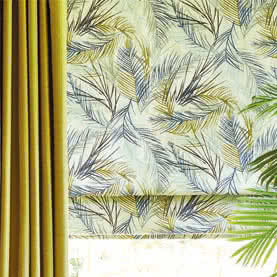 Patterned Roman blind next to Yellow curtain