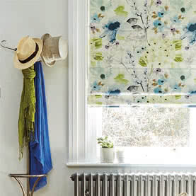 Floral Roman blinds on window above radiator