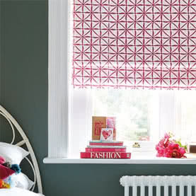 Close up of patterned red and white Roman blinds