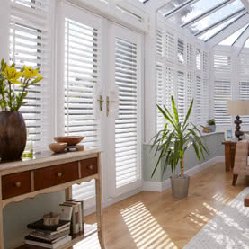 Made to measure French door shutters in conservatory
