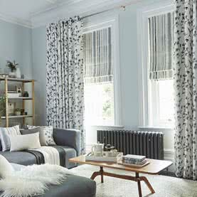Floral eyelet curtains in living room