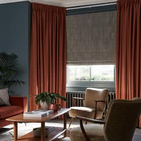 Red Pencil Pleat curtains in living room with matching furniture