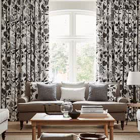 Black and white floral curtains dressing large living room window