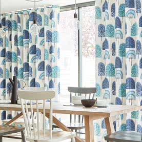 White and blue wave curtains on large dining room window