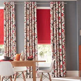 Red floral curtains next to matching blind in dining room