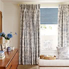 Curtains and Roman blind in bedroom